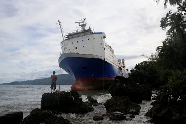 A passenger inter-island ferry Shuttle RoRo 5 is pictured after it was swept ashore at the height of Typhoon Nock-Ten in Mabini, Batangas in the Philippines December 26, 2016. (Photo by Erik De Castro/Reuters)