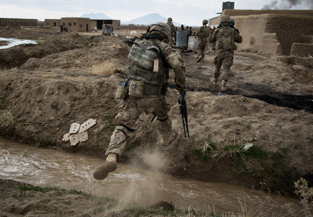 Soldiers assigned to Palehorse Troop, 4th Squadron, 2nd Calvary Regiment move over rough terrain during Operation Alamo Scout 13, Kandahar Province, Afghanistan, February 10, 2014. The operation was a joint effort between Palehorse troops and the Afghan National Army's 205th Corps Mobile Strike Force to conduct reconnaissance patrols in villages around Kandahar Airfield. (Photo by Sgt. Harold Flynn/U.S. Army)