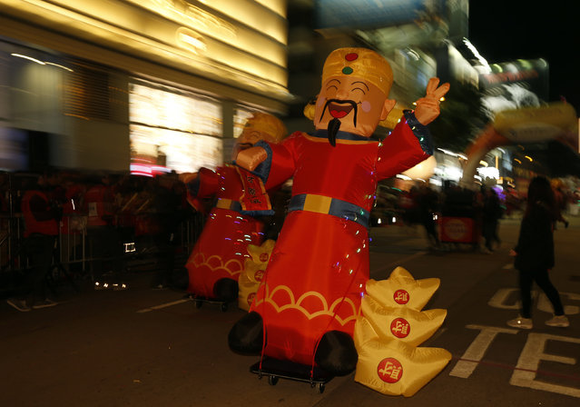 Inflatable dolls depicting the Chinese God of Wealth are displayed during a Lunar New Year parade on the first day of the Lunar New Year of the Monkey in Hong Kong, China February 8, 2016. (Photo by Bobby Yip/Reuters)