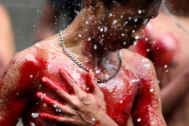 A Shi'ite muslim man bleeds after cutting himself while he takes part at the Ashura festival at a mosque in central Yangon, Myanmar, September 21, 2018. (Photo by Ann Wang/Reuters)