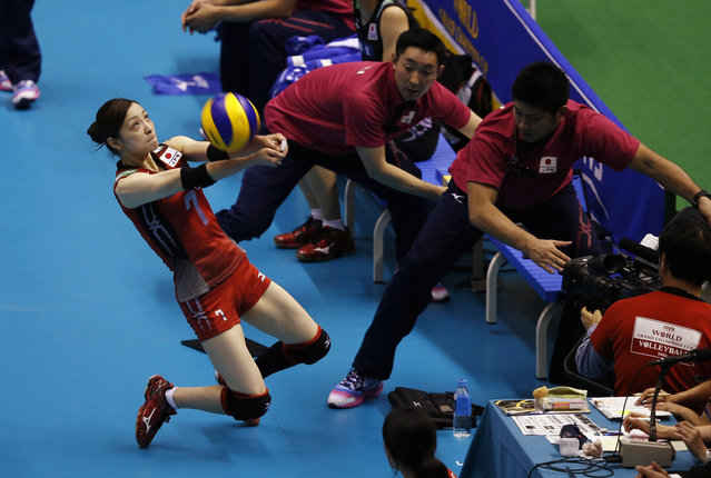 Japan's Arisa Sato (L) receives the ball to save a point against Brazil on the final day of their FIVB Women's Volleyball Grand Champions Cup 2013 in Tokyo November 17, 2013. Brazil placed first while Japan placed third. (Photo by Toru Hanai/Reuters)