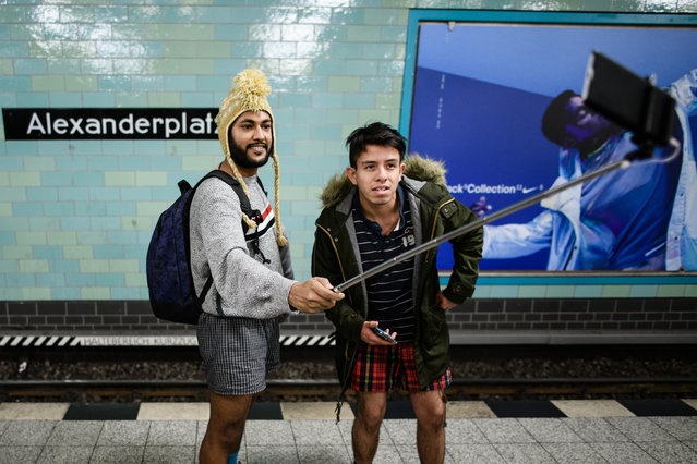 "People wearing no pants take a selfie as they participate in the worldwide event ""No Pants Subway Ride"" in Berlin, Germany, January 13, 2019. (Photo by Clemens Bilan/EPA/EFE/Rex Features/Shutterstock)"