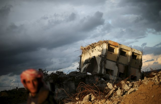 A Palestinian man looks on as he stands near a house, destroyed during 2014 war, on a winter day in the northern Gaza Strip, February 10, 2016. (Photo by Mohammed Salem/Reuters)