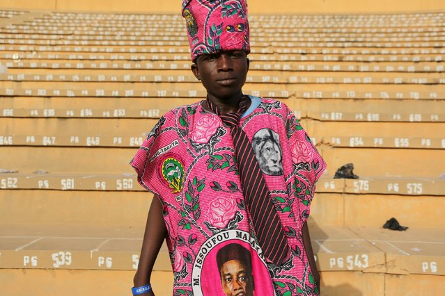 A supporter of incumbent President Mahamadou Issoufou poses for a picture at a campaign rally in Niamey, Niger, February 18, 2016. (Photo by Joe Penney/Reuters)