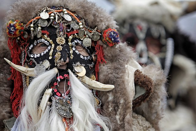 """A masked dancer from the Macedonian town of Prilep takes part in the 28th International Festival of Masquerade Games """"Surva"""" in the town of Pernik, Bulgaria Saturday, Januaru 26, 2019. (Photo by Valentina Petrova/AP Photo)"""