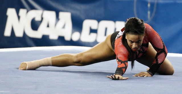 Nebraska's Ashley Lambert performs her floor exercise routine during the NCAA women's gymnastics championships Friday, April 17, 2015, in Fort Worth, Texas. (Photo by Tony Gutierrez/AP Photo)
