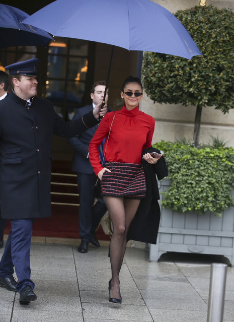 Nina Dobrev needs an umbrella whilst leaving her hotel in Paris, France on March 4, 2019. (Photo by Splash News and Pictures)