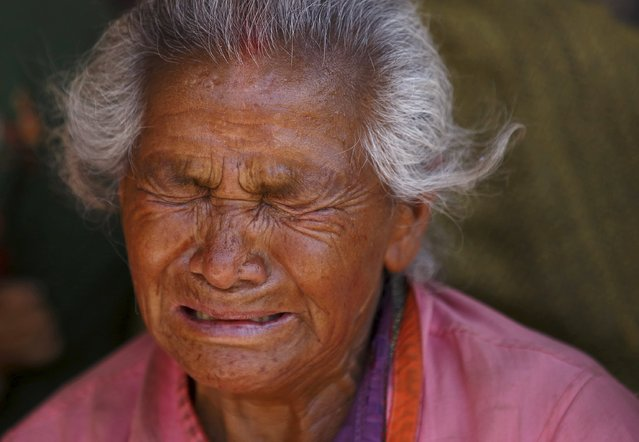 A woman mourns her granddaughter, who died in Saturday's earthquake, in Bhaktapur, Nepal April 27, 2015. (Photo by Navesh Chitrakar/Reuters)