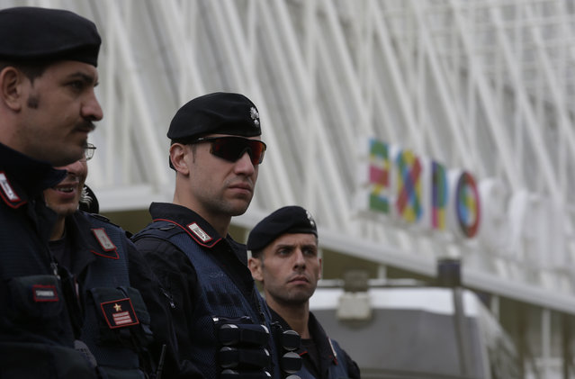 Italian Carabinieri, paramilitary police officers, patrol in front of the Expo gate during a protest against Expo 2015 in Milan, Italy, Thursday, April 30, 2015. (Photo by Antonio Calanni/AP Photo)