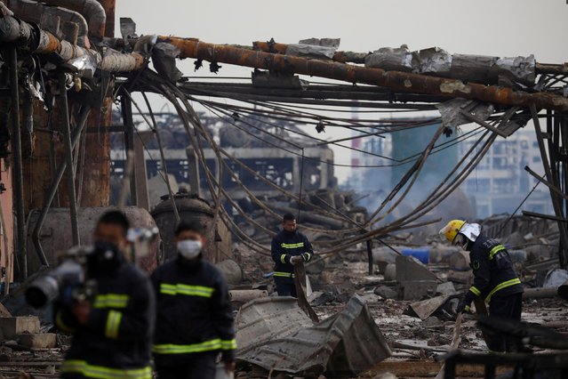Firefighters work on the site following an explosion at a pesticide plant owned by Tianjiayi Chemical, in Xiangshui county, Yancheng, Jiangsu province, China March 22, 2019. (Photo by Yang Bo/CNS via Reuters)