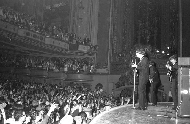 Despite a constant din of screaming teenagers, the Beatles successfully opened their U.S. tour in San Francisco on August 20, 1964. From left to right are Paul McCartney, George Harrison and John Lennon. Ringo Starr cannot be seen. (Photo by AP Photo)