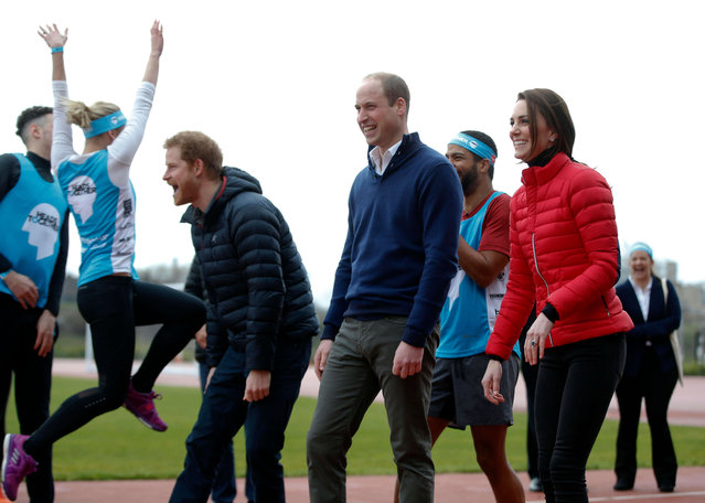 Britain's Prince William, centre, Kate, the Duchess of Cambridge, right, and Prince Harry react as they take part in a relay race, during a training event to promote the charity Heads Together, at the Queen Elizabeth II Park in London, Sunday, February 5, 2017. (Photo by Alastair Grant/AP Photo)