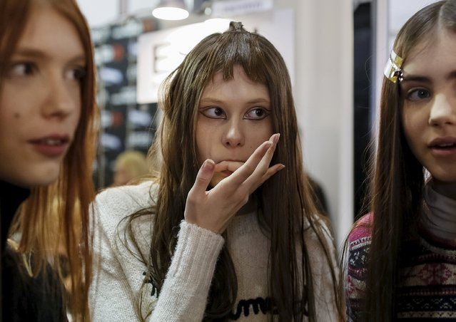 Models wait backstage during Ukrainian Fashion Week in Kiev, March 17, 2016. (Photo by Gleb Garanich/Reuters)