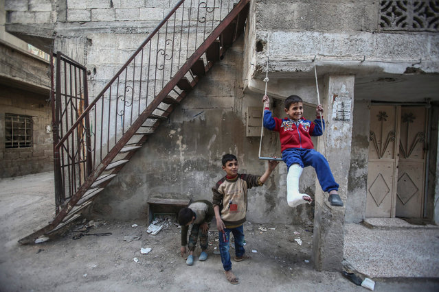 A picture made available 23 March 2016 shows Syrian children playing on a street in the Teshreen neighbourhood of Damascus, Syria, 22 March 2016. The area is controlled by forces opposing the Syrian regime. (Photo by Mohammed Badra/EPA)