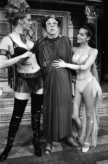 """American comic actor, Phil Silvers, with Patricia Peters and Rikki Howard in """"A Funny Thing Happened on the Way to the Forum"""", 29th January 1974. (Photo by Victor Blackman/Express/Getty Images)"""
