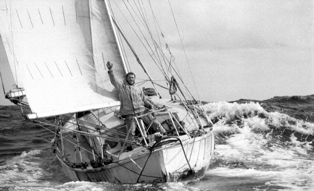 This 1969 photo provided by Bill Rowntree/PPL Media shows Robin Knox-Johnston waving aboard his 32-foot yacht Suhaili off the coast of Falmouth, England, after becoming the first man to sail solo non-stop around the globe. In the spring of 1969, less than three months before man landed on the moon, Knox-Johnston achieved the nautical equivalent of climbing Mount Everest when he became the first man to sail alone around the world nonstop. GPS hadn't been invented, so the veteran of the British merchant navy made his way around the globe the old-fashioned way, with a sextant. (Photo by Bill Rowntree/PPL Media via AP Photo)