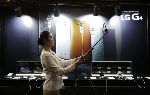 A model takes a selfie with an LG Electronics' new G4 smartphone during its unveiling ceremony in Seoul, South Korea Wednesday, April 29, 2015. (Photo by Ahn Young-joon/AP Photo)