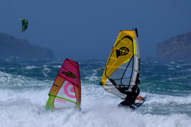 People practise windsurf in heavy waves as strong wind blows at the Plage du David beach in downtown Marseille, as storm Eleanor hits southern parts of France on May 5, 2019. (Photo by Boris Horvat/AFP Photo)