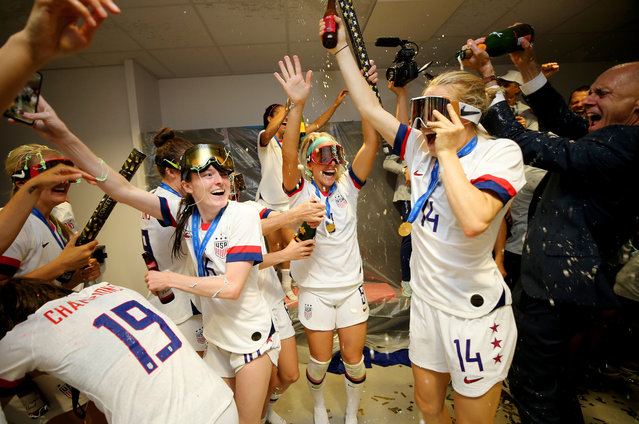 Players of the USA celebrate in the dressing room following their team's victory in the 2019 FIFA Women's World Cup France Final match between The United States of America and The Netherlands at Stade de Lyon on July 07, 2019 in Lyon, France. (Photo by Maddie Meyer – FIFA/FIFA via Getty Images)