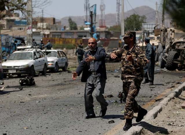Afghan security personnel react at the site of a suicide bomb attack in Kabul, Afghanistan June 30, 2015. (Photo by Ahmad Masood/Reuters)