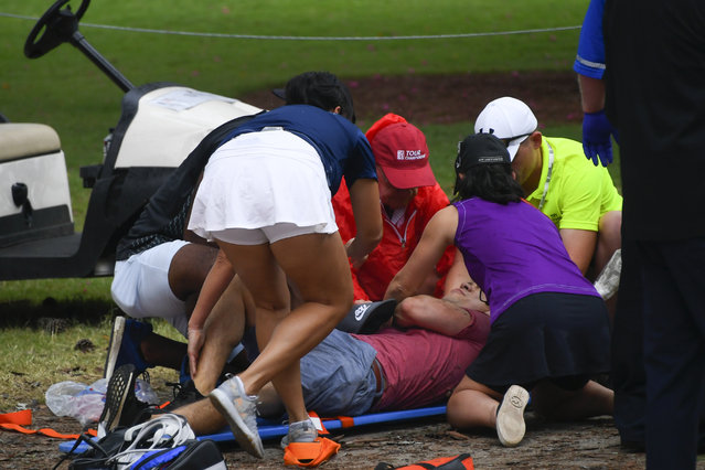 A spectators is tended to after a lightning strike on the course which left several injured during a weather delay in the third round of the Tour Championship golf tournament Saturday, August 24, 2019, in Atlanta. (Photo by John Amis/AP Photo)