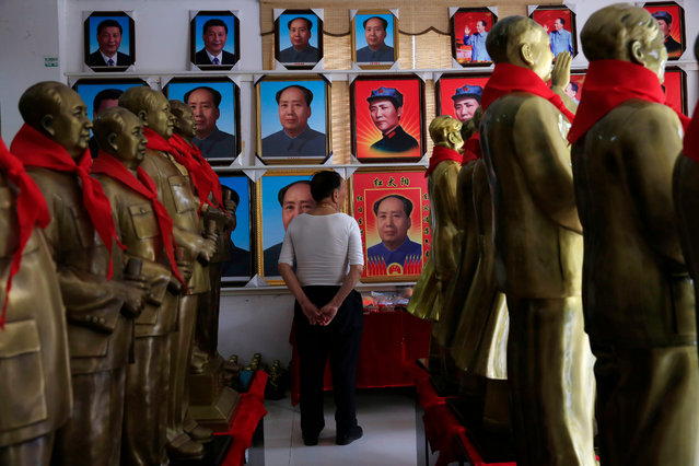 "A visitor looks at portraits of Mao Zedong amid his statues on display at a wholesale souvenir store in Shaoshan, Hunan Province in central China, 28 April 2016. Shaoshan is the hometown of former Communist leader Mao Zedong, popularly known as Chairman Mao. Thousands of visitors descend on this small Chinese town burrowed in the hills of Central China's Hunan province to pay homage to the ""Great Helmsman"" everyday. (Photo by How Hwee Young/EPA)"