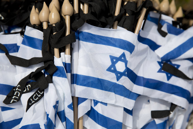 Israeli flags in a box before they are placed on graves of fallen soldiers on the eve of Memorial Day at the Kiryat Shaul military cemetery in Tel Aviv, Israel, Tuesday, May 10, 2016. (Photo by Ariel Schalit/AP Photo)