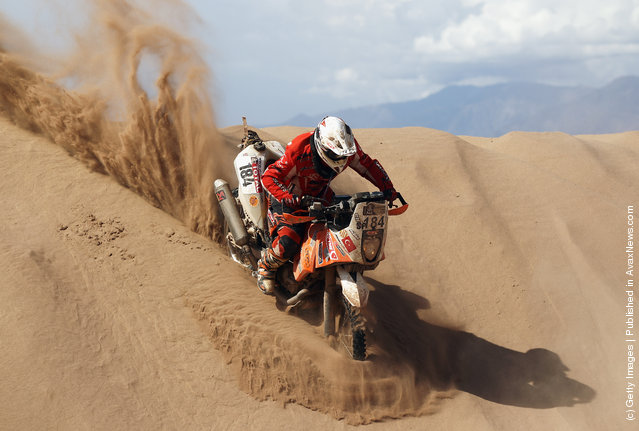 Senkalayci Sakir of Turkey and Turkish Team rides down a sand dunes during stage five of the 2012 Dakar Rally