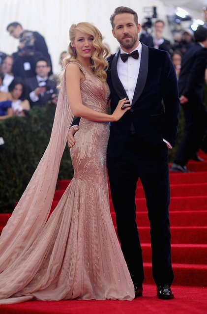 "Blake Lively (L) and Ryan Reynolds attend the ""Charles James: Beyond Fashion"" Costume Institute Gala at the Metropolitan Museum of Art on May 5, 2014 in New York City. (Photo by Dimitrios Kambouris/Getty Images)"