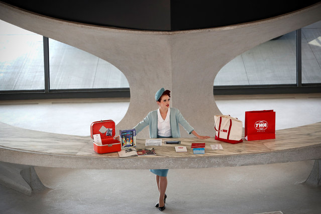 A worker in period costume stands behind a reception desk in the main lobby of the TWA Hotel, which is housed inside the former 1962 TWA Flight Center terminal which was designed by architect Eero Saarinen at JFK International Airport in New York, U.S., October 2, 2019. (Photo by Mike Segar/Reuters)