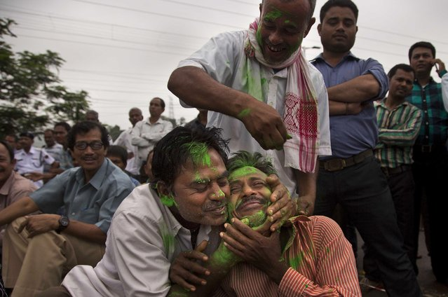 Bharatiya Janata Party, (BJP) supporters smeared colors after winning Assam state election in Gauhati, India, Thursday, May 19, 2016. India's ruling Hindu nationalist has made dramatic gains in elections in the eastern state of Assam but trails in four other states that went to polls earlier this month. Data from India's election commission on Thursday showed that Prime Minister Narendra Modi's Bharatiya Janata Party and its allies will form the government in Assam, which has been ruled by the opposition Congress party for 15 years.(Photo by Anupam Nath/AP Photo)