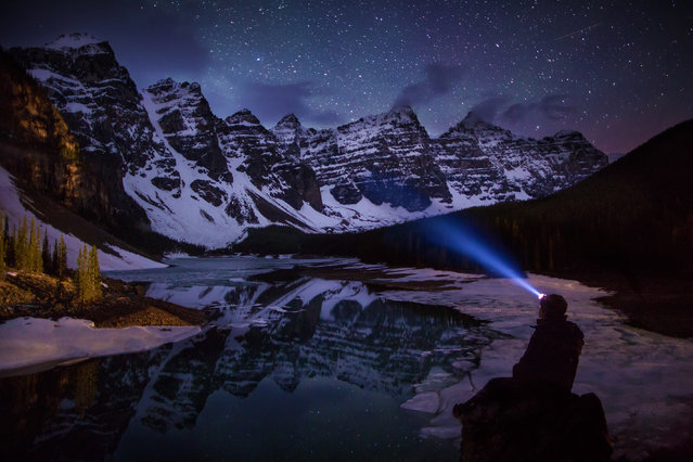 "Paul Zizka in ""Midnight At Moraine Lake"", Moraine Lake, Banff National Park, May 29, 2013. (Photo by Paul Zizka/Caters News)"