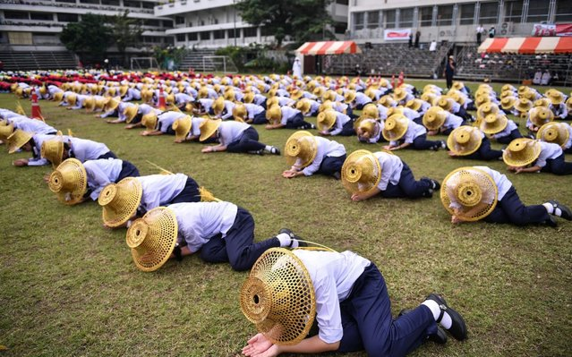 Thai students hold a rehearsal at a school grounds in Bangkok on November 13, 2019, in preparation for Pope Francis' visit. (Photo by Chalinee Thirasupa/AFP Photo)