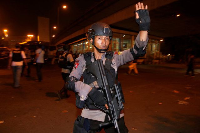 Police guard looks on at scene of an explosion in Jakarta, Indonesia May 24, 2017. (Photo by Darren Whiteside/Reuters)