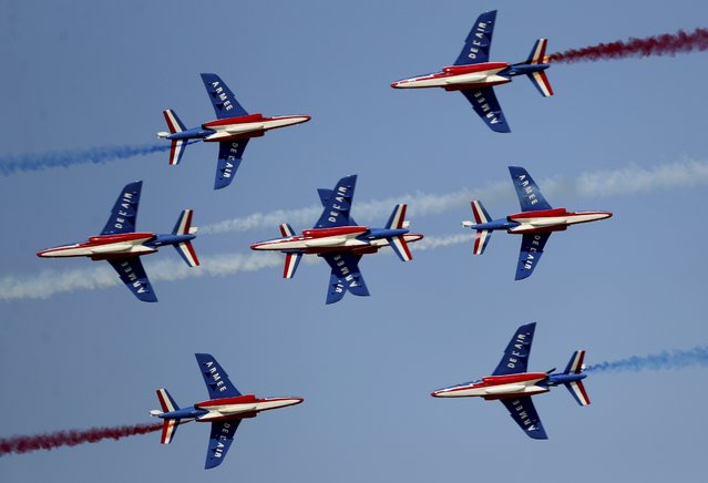 French aircrafts of the Patrouille de France spray colored smoke during a performance on the opening day of the Dubai Airshow in Dubai, United Arab Emirates, Sunday, November 17, 2019. (Photo by Kamran Jebreili/AP Photo)