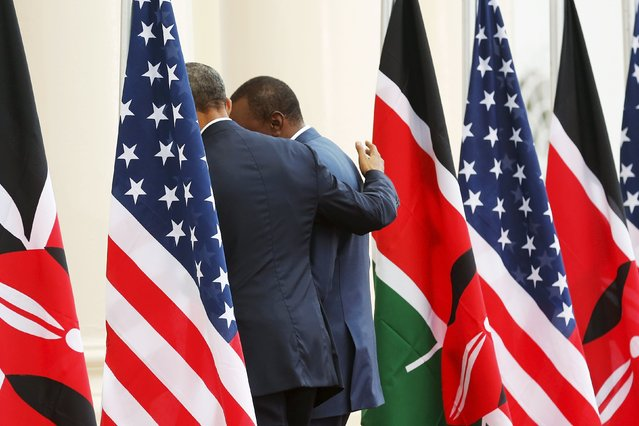 U.S. President Barack Obama (L) puts his arm around Kenya's President Uhuru Kenyatta as they depart after their joint news conference after their meeting at the State House in Nairobi July 25, 2015. (Photo by Jonathan Ernst/Reuters)