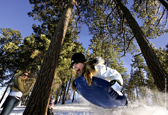 Lindsay Heimbach goes airborne while sledding down a hill on Mt. Lemmon Dec. 27, 2008. Scores of others had the same idea as traffic lined up to take advantage of the snow which was estimated to be between 27-36 inches deep at Ski Valley, which opened for the first day