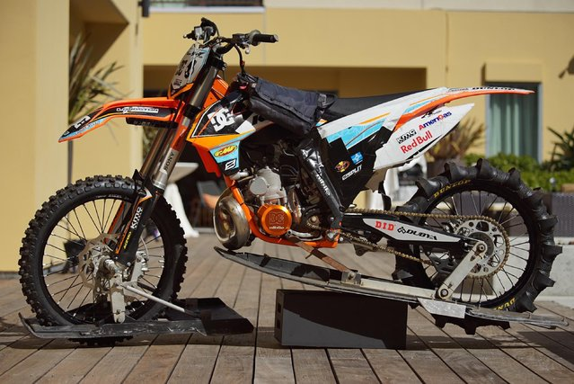 This August 2, 2015, photo provided by DC Shoes shows the specially-modified motorcycle daredevil Robbie Maddison rode in his latest stunt rides across waves in Tahiti, French Polynesia, using ski-like devices on the wheels, on display in Huntington Beach, Calif.  (Photo by Matt Francis/DC Shoes via AP Photo)