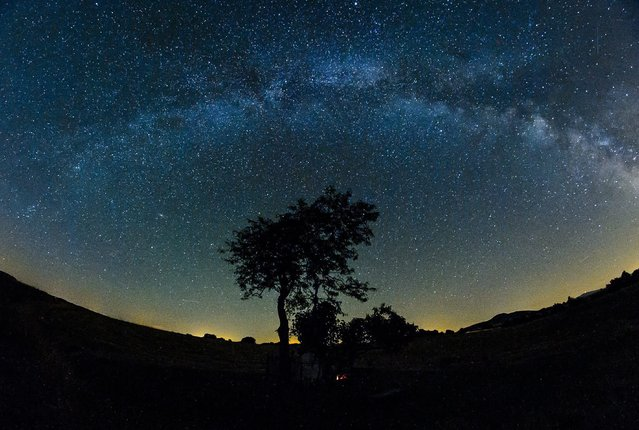 """A photo made available 21 July 2015 of the glowing band of the so-called """"Milky Way"""" seen in the summer night sky over the vicinity of Salgotarjan, 109 kilometers northeast of Budapest, Hungary, late 20 July 2015. The """"Milky Way"""" is the galaxy that contains our own Solar system and appears as a disc shape bright band in the sky, although it can rarely been seen by the naked eye. (Photo by Peter Komka/EPA)"""