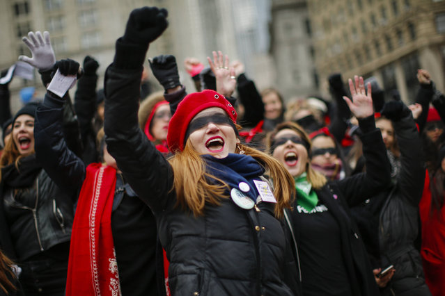 Women take part in a rally before the Women's Women's March  on Saturday, January 18, 2020 in New York. Hundred showed up in New York City and thousands in Washington, D.C. for the rallies, which aim to harness the political power of women, although crowds were noticeably smaller than in previous years. Marches were scheduled Saturday in more than 180 cities. (Photo by Eduardo Munoz Alvarez/AP Photo)