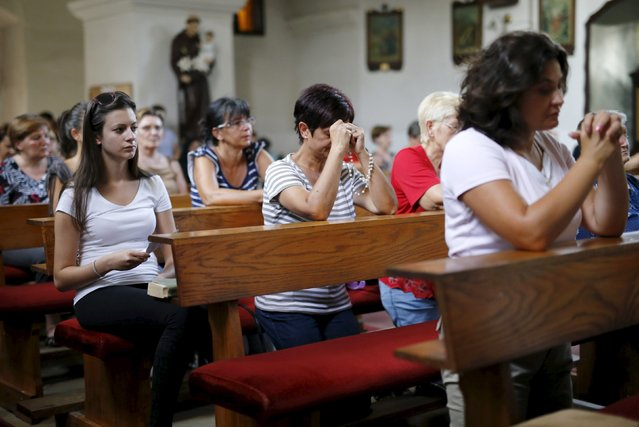Women pray for Tomislav Salopek in local church in Vrpolje village, Croatia, August 12, 2015. An Egyptian group allied to Islamic State has published a photograph it says showed the beheaded body of a Croatian hostage it threatened to kill last week, the SITE monitoring service said on Wednesday. (Photo by Antonio Bronic/Reuters)