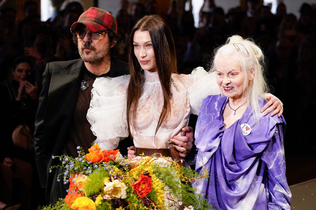 (L-R) Andreas Kronthaler, Bella Hadid and Vivienne Westwood walks the runway during the Vivienne Westwood show as part of the Paris Fashion Week Womenswear Fall/Winter 2020/2021 on February 29, 2020 in Paris, France. (Photo by Peter White/Getty Images)