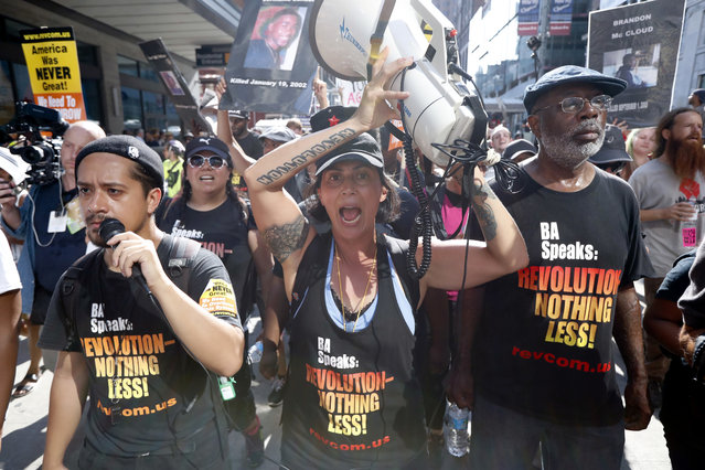 Protesters march in downtown on Tuesday, July 19, 2016, in Cleveland, during the second day of the Republican convention. (Photo by John Minchillo/AP Photo)