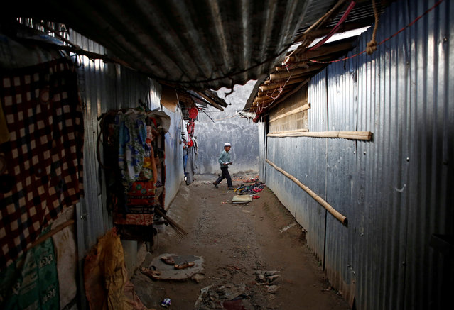 A Rohingya refugee boy enters a classroom made of corrugated metal in Kathmandu, Nepal September 11, 2017. There are about 300 Rohingya refugees living in Nepal since 2012 in two tin roofed camps on the outskirts of Kathmandu. Many of them say they want to go back to their homes if there was security, peace and a guarantee for equal treatment. (Photo by Navesh Chitrakar/Reuters)