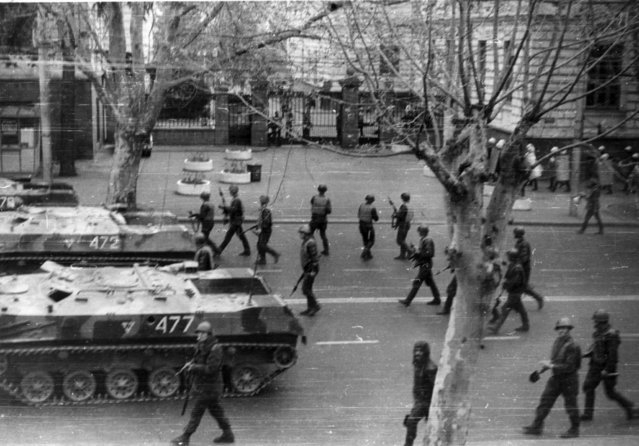Soviet troops during a brutal crackdown on Georgian independence protesters in Tbilisi in 1989. As Georgian calls for independence from the U.S.S.R were growing louder, Abkhaz began to petition for their own republic inside the Soviet Union. (Photo by TASS/Stringer)