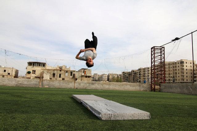 Syrian gymnast Ahmad al-Sawas practises in the rebel-held Bustan al-Qasr neighbourhood of Aleppo, Syria March 23, 2016. (Photo by Abdalrhman Ismail/Reuters)
