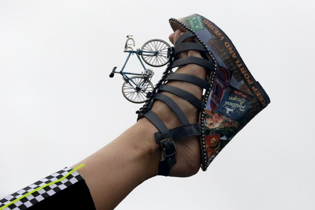 Miss Oregon Rebecca Anderson displays her shoe during the Miss America Shoe Parade at the Atlantic City boardwalk, Saturday, Sept. 13, 2014, in Atlantic City, N.J. (Photo by Julio Cortez/AP Photo)
