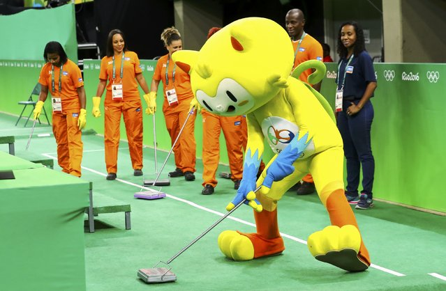 2016 Rio Olympics, Trampoline Gymnastics, Preliminary, Men's Qualification, Rio Olympic Arena, Rio de Janeiro, Brazil on August 13, 2016. Olympics mascot Vinicius performs ahead of the men's trampoline event. (Photo by Mike Blake/Reuters)