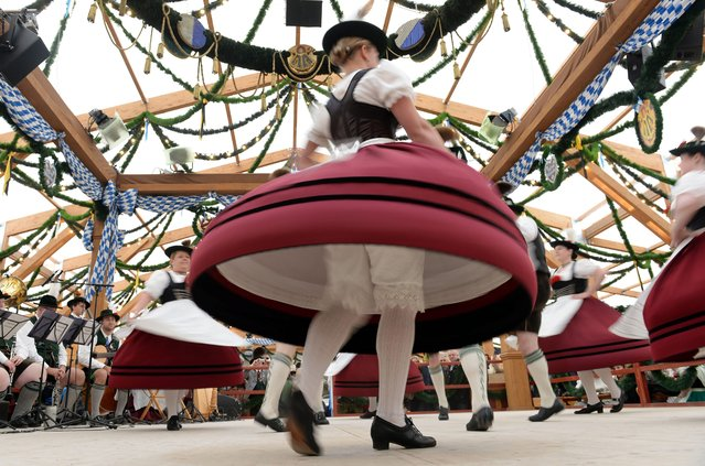 """Women wearing traditional Bavarian attire dance on the stage of the funfair tent """"Festzelt Tradition"""" at the 181st Oktoberfest in Munich, Germany, 22 September 2014. The annual beer festival runs from 20 September to 05 October. (Photo by Andreas Gebert/EPA)"""