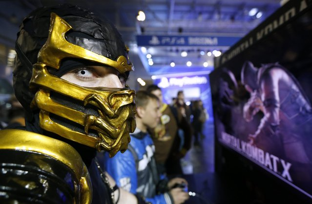 "A participant dressed as the character ""Scorpion"" from the upcoming 2015 ""Mortal Kombat X"" fighting game is seen at Comic-Con Russia convention and IgroMir 2014 exhibition in Moscow, October 3, 2014. (Photo by Sergei Karpukhin/Reuters)"
